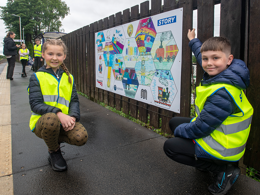 Mural made by local school children welcomes passengers to Mills Hill station